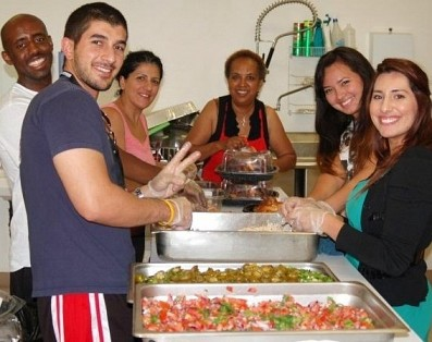 Preparing a meal for the homeless.